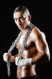 The muscular man with metal chain Stock Photo