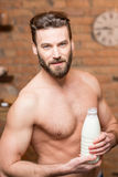 Muscular man with milk Stock Image