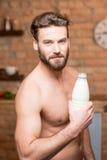 Muscular man with milk Stock Photos
