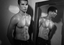 Muscular man and mirror Stock Image
