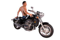 Muscular man and motorcycle. Back view of a sexy muscular man sitting on a motorcycle Stock Photography