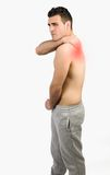 Muscular man with muscle pain Stock Photo