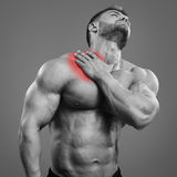 Muscular man neck pain Stock Image