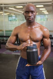 Muscular man with nutritional supplement Royalty Free Stock Photo