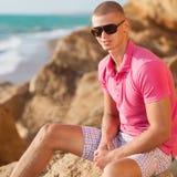 Muscular man and ocean Stock Image