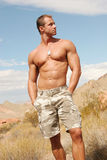 Muscular Man On Red Rocks Stock Photo
