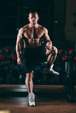 Muscular man out in gym standing near dumbbells , strong male naked torso abs Stock Photos