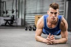 Muscular man planking stock image