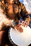 Muscular man playing drum. Stock Image