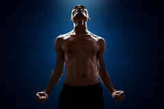 Muscular man pose. Muscular man power and strong pose Stock Photo
