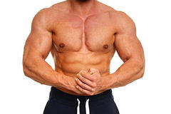 Muscular man poses Stock Photography