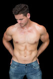 Muscular man posing in blue jeans Royalty Free Stock Photo
