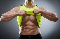 Muscular man posing in dark studio Royalty Free Stock Photography