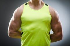 Muscular man posing in dark studio Royalty Free Stock Image