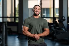 Muscular Man Posing In Green T-shirt
