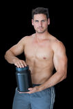 Muscular man posing with nutritional supplement Royalty Free Stock Photography