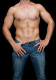 Muscular man posing shirtless in blue jeans Royalty Free Stock Photography
