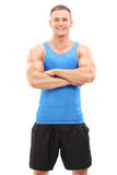 Muscular man posing on white background royalty free stock photography