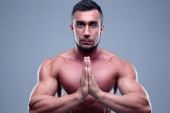 Muscular man praying Stock Photography