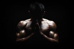 Muscular Man Praying. Spiritual Concentration Concept stock photography