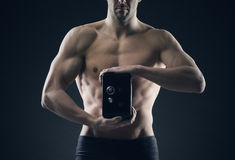 Muscular man protects savings Royalty Free Stock Photo
