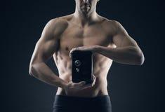 Muscular man protects savings Royalty Free Stock Photo