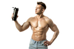Muscular man with protein drink in shaker. Over white background royalty free stock images