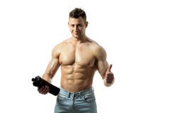 Muscular man with protein drink in shaker. Over white background stock photography