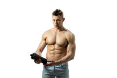 Muscular man with protein drink in shaker. Over white background stock photos