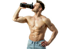 Muscular man with protein drink in shaker. Over white background stock photo