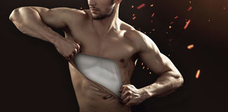 Muscular man pulling his chest skin away Royalty Free Stock Photo