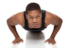 Muscular man pushups Royalty Free Stock Photos