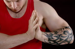 Muscular man in a red T-shirt Stock Image