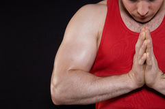 Muscular man in a red T-shirt Royalty Free Stock Images
