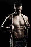 Muscular man with rope Stock Photography