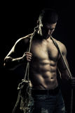 Muscular man with rope Royalty Free Stock Images