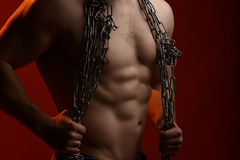 Muscular man with rope Stock Photo
