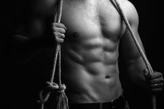 Muscular man with rope Stock Photos