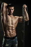 Muscular man with rope Stock Image