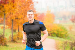 Muscular man running on a footpath Royalty Free Stock Photo