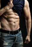 Muscular man with shirt on shoulder Stock Photos