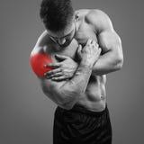 Muscular man Shoulder pain Stock Image