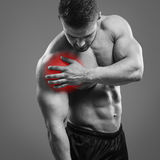 Muscular man Shoulder pain Royalty Free Stock Photography
