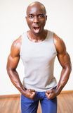 Muscular man shouting while flexing muscles Royalty Free Stock Images