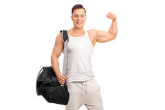 Muscular man showing his bicep Stock Images