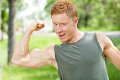Muscular man showing his biceps Royalty Free Stock Images