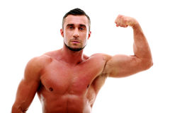 Muscular man showing his biceps Royalty Free Stock Photography