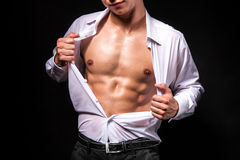 Muscular man showing his chest during striptease Royalty Free Stock Images