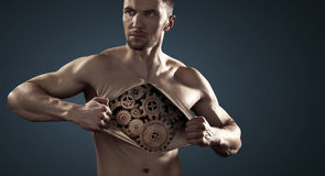 Muscular man showing his internal mechanism Stock Images