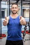 Muscular man showing thumbs up Royalty Free Stock Photos